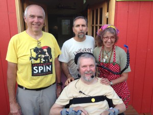 David Oaks in powerchair with his big brother Tony Oaks, friend Rev. Phil Schulman, wife Debra Nunez.
